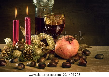 Rustic traditional christmas still-life with wine and seasonal fruits - stock photo