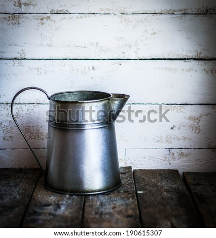 Rustic vase on wooden background