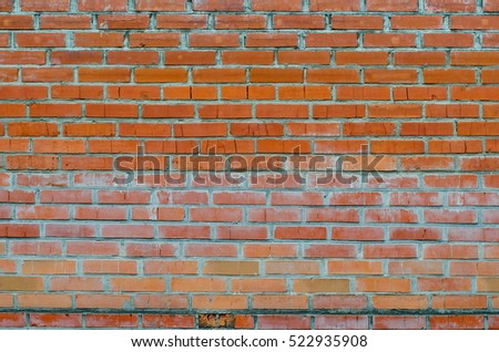 Rustic vintage background of red brick wall cladding with cement seams
