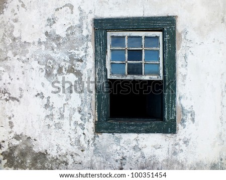 rustic wall and old wooden window - stock photo