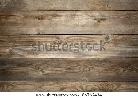 rustic weathered wood background with grain and knots - stock photo