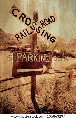 Rustic western railroad crossing with grungy texture effect