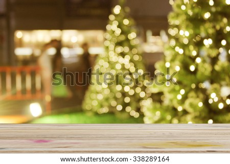rustic wood table in front of christmas light night,abstract circular bokeh background  - stock photo