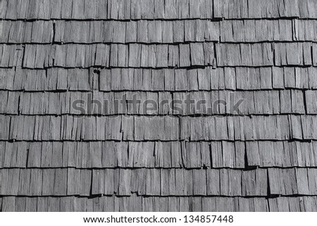 Rustic wood tiling roof - stock photo