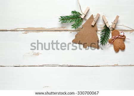 Rustic wooden background decorated with simple handmade decorations and gingerbread