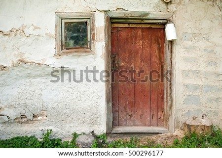Rustic wooden barn door with white milk can, background