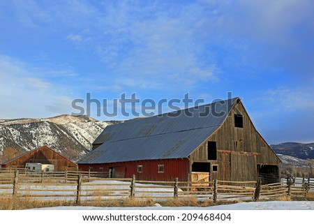 Rustic wooden barn on a farm in rural Utah, USA. - stock photo