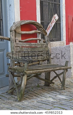 Rustic wooden bench in an alley of the town of Motovun