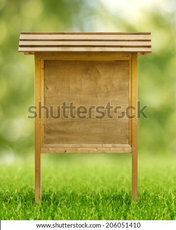 rustic wooden notice board in public park - stock photo
