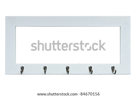 Rustic wooden photo frame with row of steel hooks - isolated on black background - stock photo