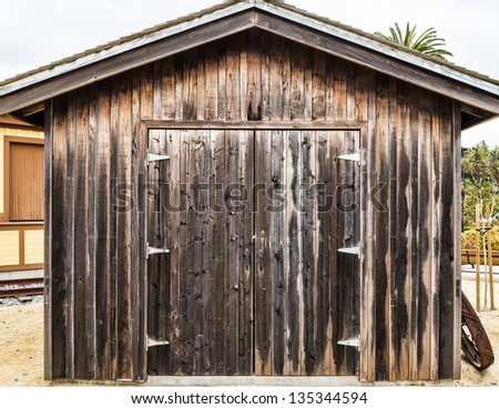 Rustic wooden traditional barn - stock photo