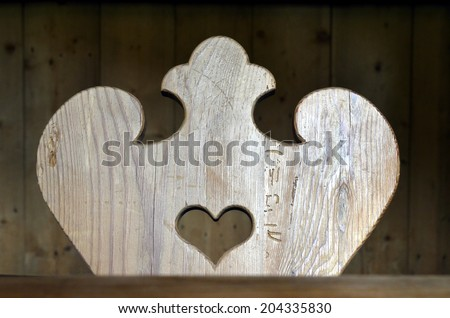 Rustic wooden vintage chair with love hearts inside. Love heart shape cut in wood - stock photo