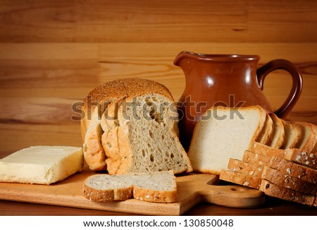 rustical still life with bread, butter and jam - stock photo
