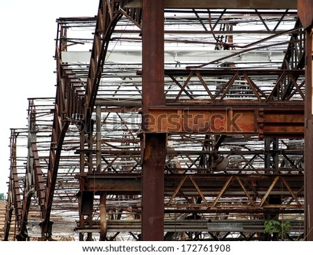 Rusting beams and girders of a deserted factory building