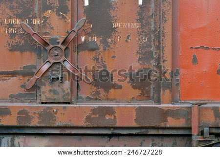 Rusting handles on an old abandoned freight car - stock photo