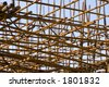 Rusting rebar lays in a construction site - stock photo
