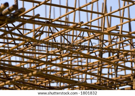 Rusting rebar lays in a construction site