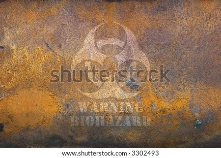 Rusting tank with biohazard warning - stock photo