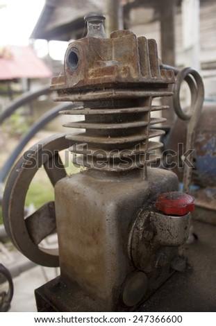 Rusty air compressor (belt drive) - stock photo