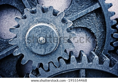 rusty and metallic gear wheel with vintage effect - stock photo