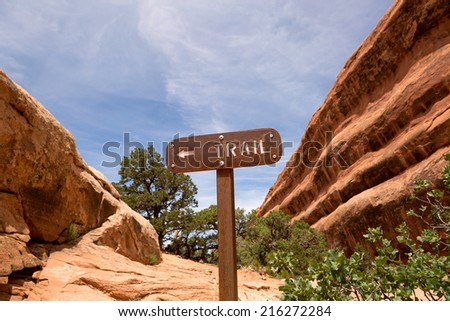 rusty back-country trail sign in Arches National Park Utah - stock photo