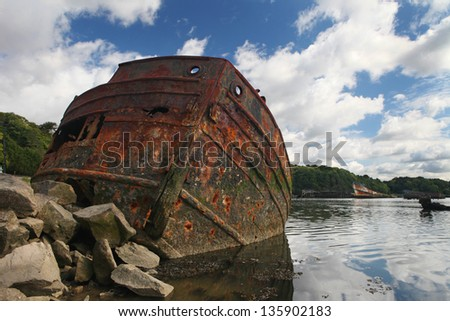 Rusty boat.        Old rusty iron boat stranded and abandoned in Kerhervy, Lorient, Brittany, France