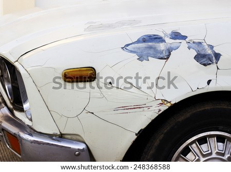 rusty car detail with color drop off - stock photo