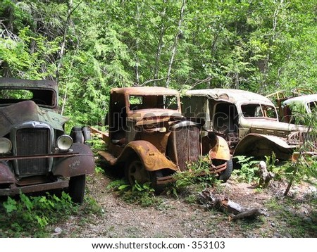Rusty cars are among the remnants from a mining operation deep in the Willamette National Forest. - stock photo