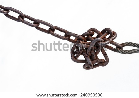 Rusty chain knot isolated on white background - stock photo