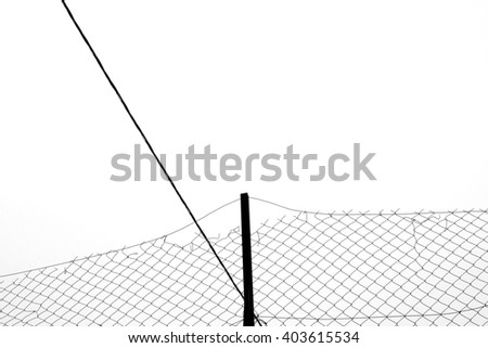 Rusty chain link fence silhouette and cable abstract background. Black and white. - stock photo