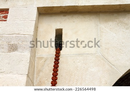 rusty chain on old castle entrance, system for the wooden bridge that becomes the door - stock photo