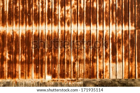 Rusty Corrugated Metal Wall Background or Backdrop with Vertical Pattern - stock photo