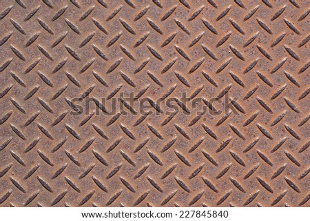 Rusty diamond metal plate texture and background - stock photo