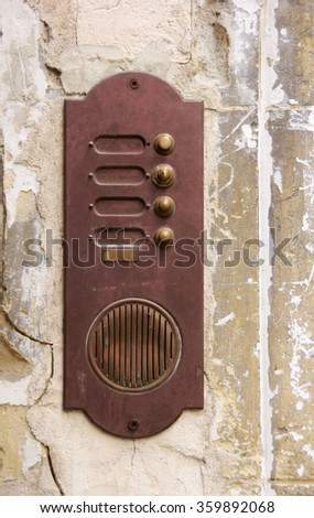 Rusty door bell on an abandoned house entrance - stock photo