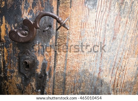 rusty door handle on an old door