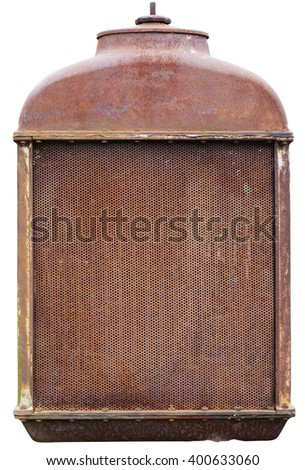 Rusty front grille of a vintage farmer American tractor of production of the beginning of the twentieth century. Isolated with patch - stock photo