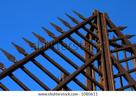rusty grid and blue sky
