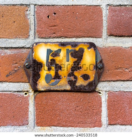 rusty house number fifty seven - stock photo