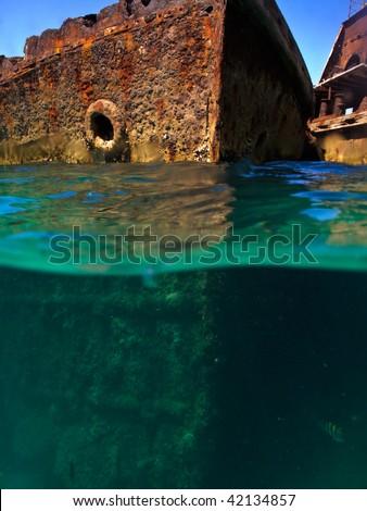 Rusty hulls of shipwrecks at Moreton Island, Australia - stock photo