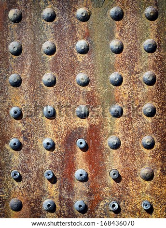 rusty iron background with rivets - stock photo
