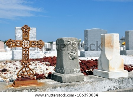 Rusty Iron Cross And Tombstones In Cemetery - stock photo