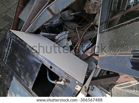 rusty iron ore dump in special waste landfill - stock photo