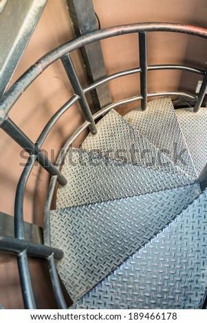 Rusty iron spiral stair - stock photo