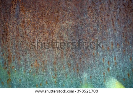 Rusty iron surface old grunge brown blue sheet of iron fragment of protective structure made of metal plate closeup on armor textured background - stock photo