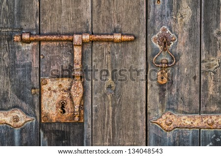 Rusty key-hole and door knocker with great colors