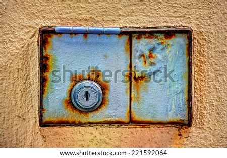 rusty keyhole in hdr tone - stock photo