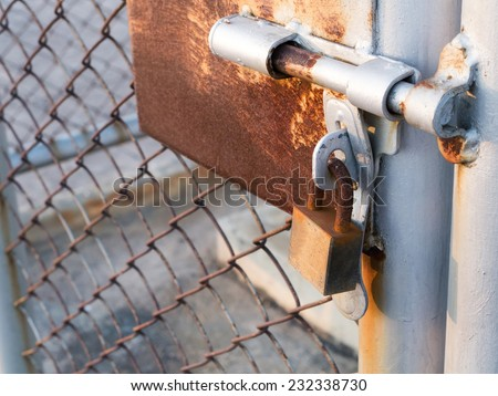 rusty lock and bars