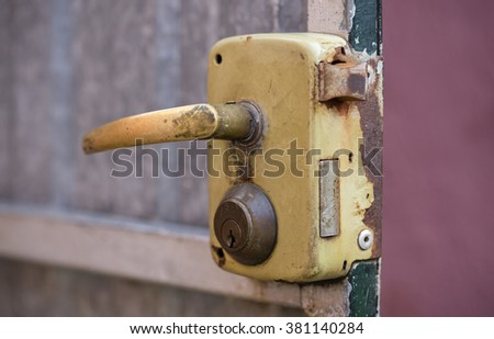 Rusty lock and handle detail in a door