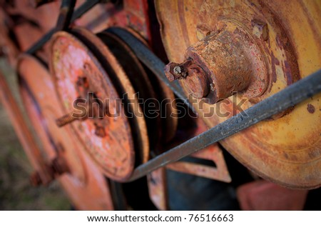 rusty machine wheels and pulleys textured - stock photo