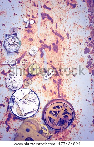 rusty mechanism from the old clock on the texture background/vintage time concept background